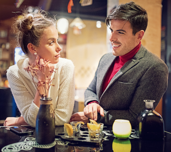 Woman looks disinterested on a date
