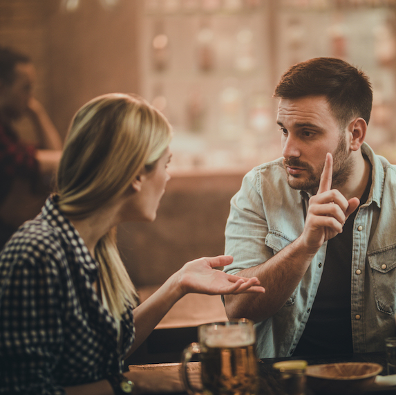 Couple argues in a bar