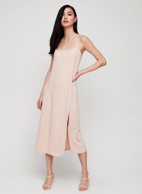 Model wears blush pink slip dress