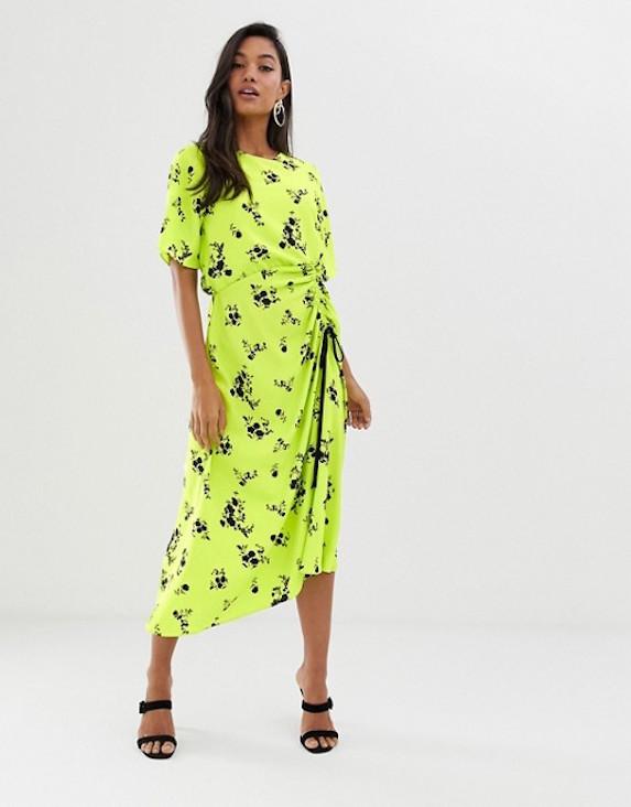 Model wears a neon floral print midi dress