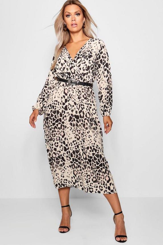 Plus-size model wears an animal-print style dress