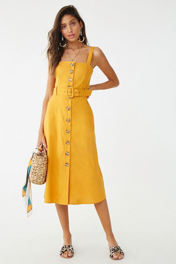 Model wears yellow belted dress