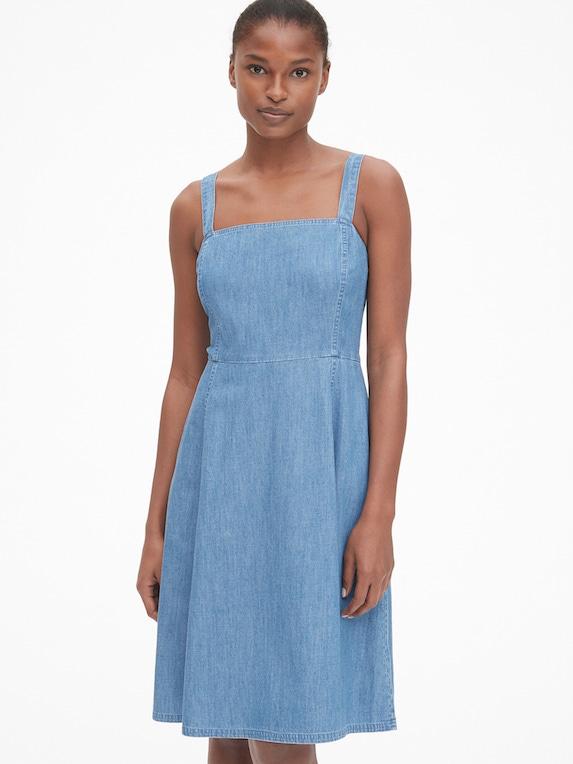 Model wears denim dress