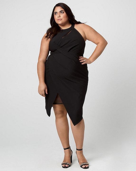 Roxy Earle wears a black cocktail dress