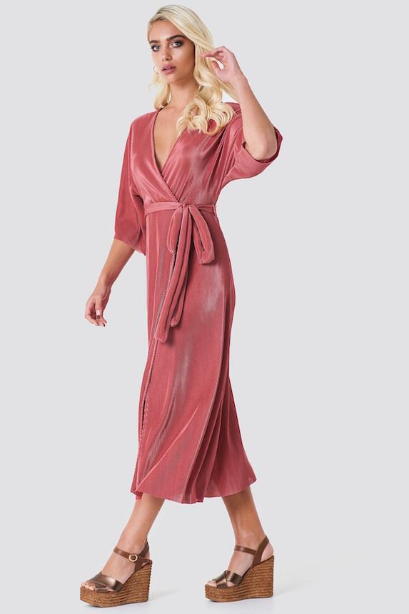 Model wears pink wrap-style kimono dress
