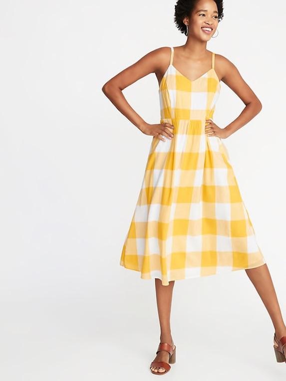 Model wears yellow gingham print dress