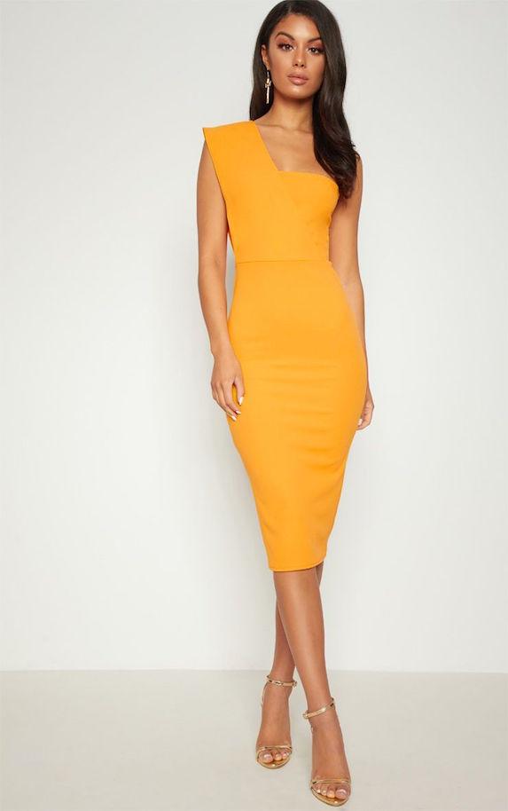 Model wears yellow one-shoulder midi dress