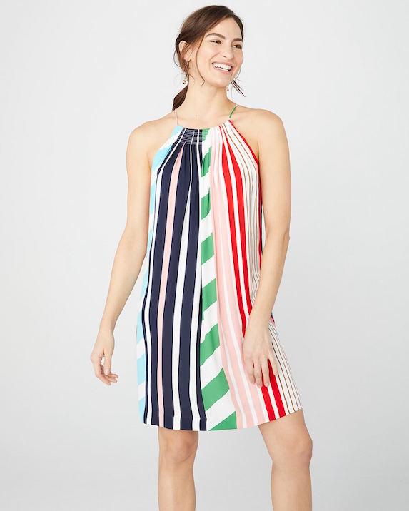 Model wears multi-coloured shift dress