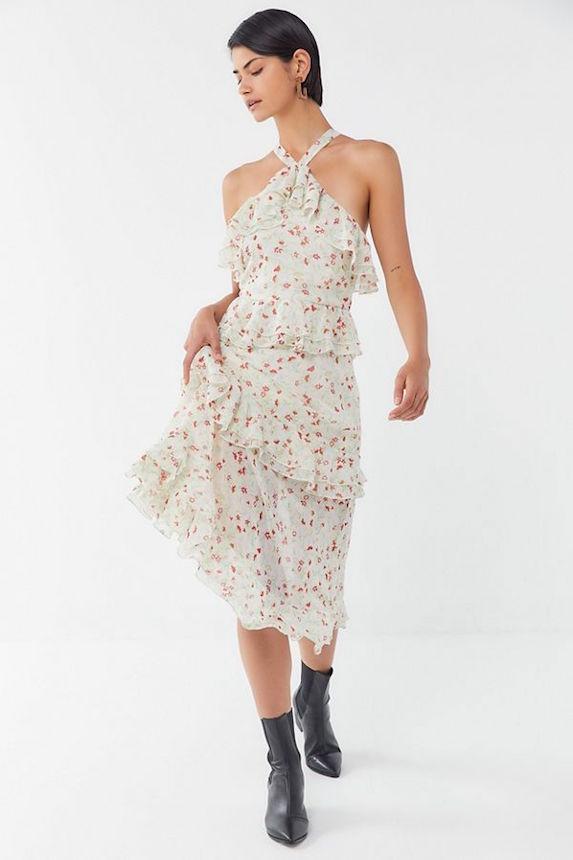 Model wears a halter dress with ruffles