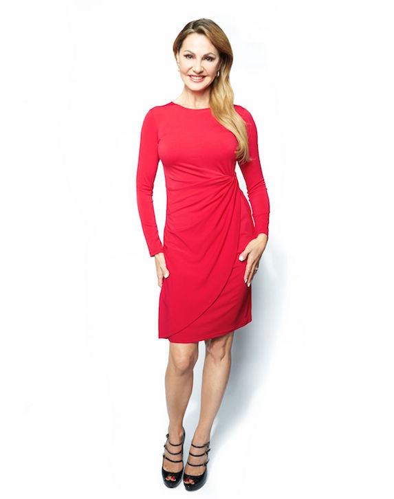 Joan Kelley Walker wears a red dress of her own design