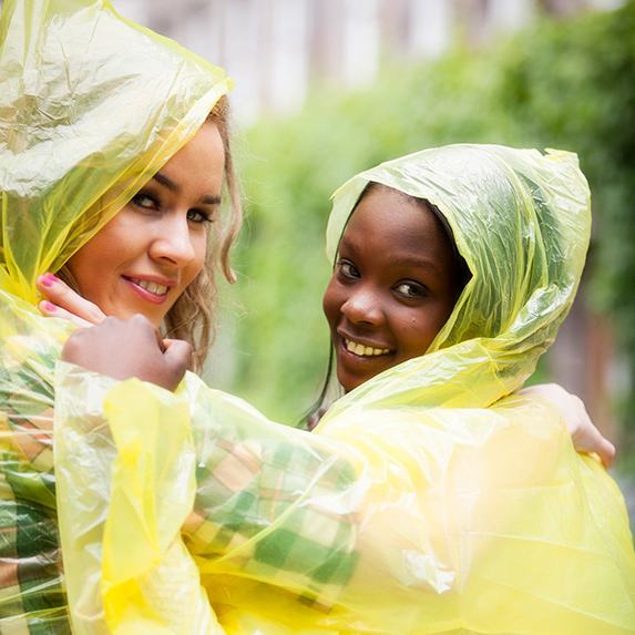 Girls happy they have their ponchos