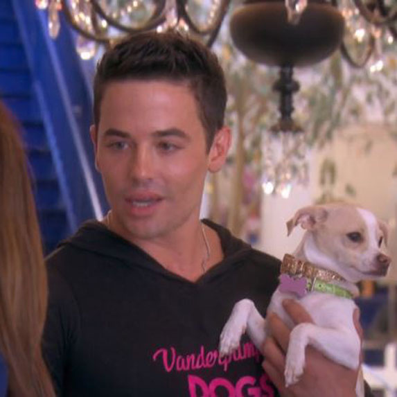 John Sessa holding Lucy Lucy Apple Juice at Vanderpump Dogs