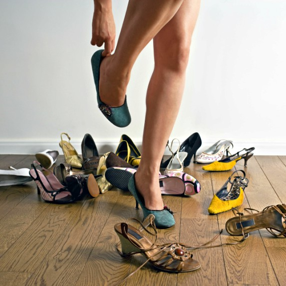 Woman tries on various heels