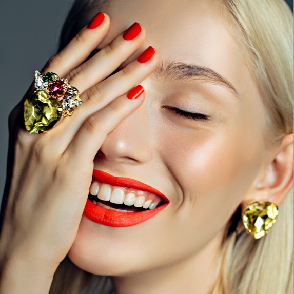 Woman shows off rings in a fancy face palm