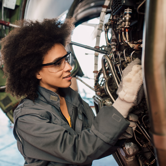 Aircraft maintenance engineer working on a plane