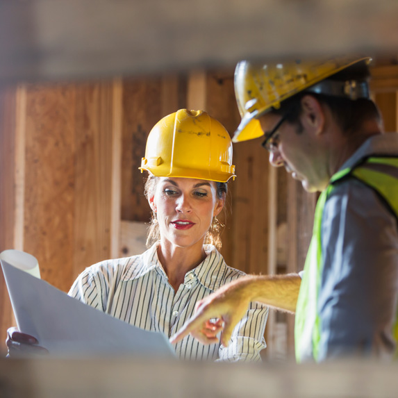 Construction manager speaking with worker