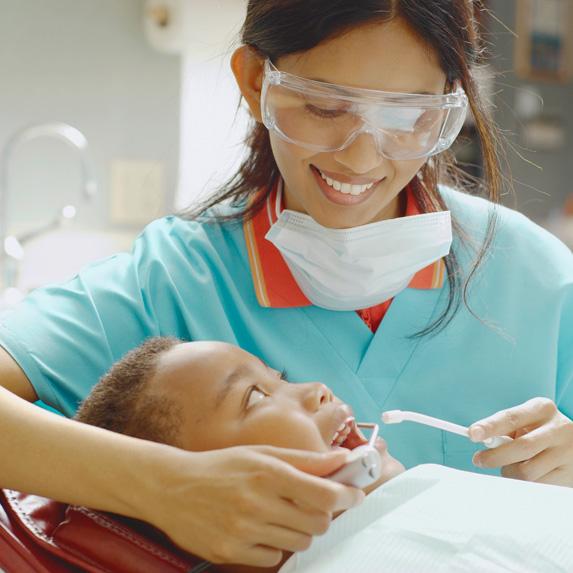 Dental hygienist working on patient