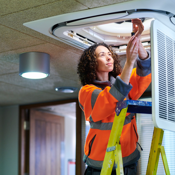 HVAC technician working in commercial building