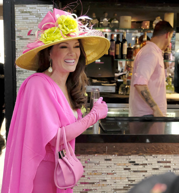 Lisa Vanderpump wearing luxurious outfit and hat
