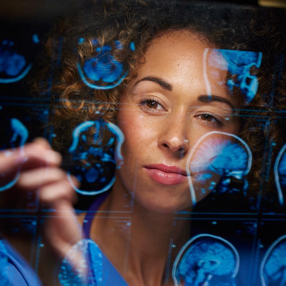 Neurosurgeon looking at scans