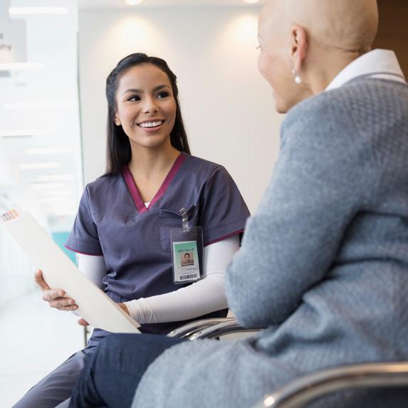 Registered nurse speaking with patient