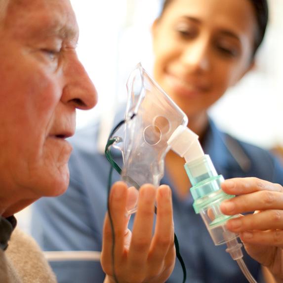 Respiratory therapist helping patient