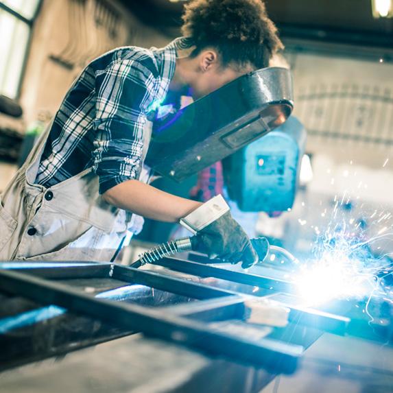 Welders in a metal shop