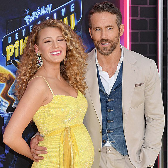 a pregnant Blake Lively at an event with husband Ryan Reynolds