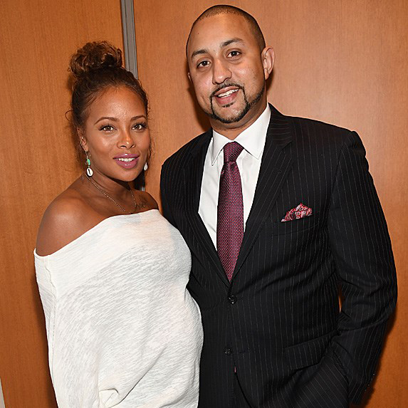 a pregnant Eva Marcille with husband Michael Sterling