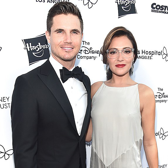 Italia Ricci and her husband Robbie Amell at an event