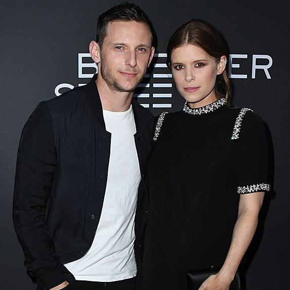 a pregnant Kate Mara with her husband Jamie Bell at an event