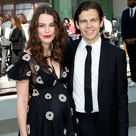 a pregnant Keira Knightley on the red carpet with her husband