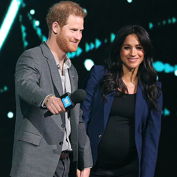Prince Harry and a pregnant Meghan Markle at an event