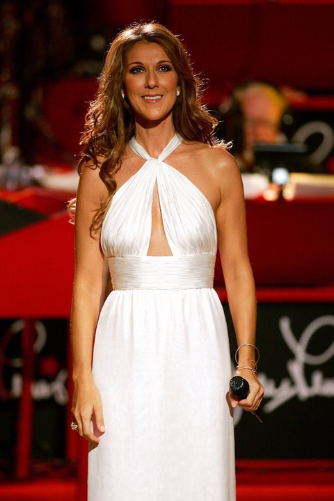 Celine Dion wears a white gown while performing on stage in 2006