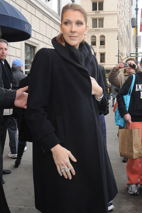 A pregnant Celine Dion wears a black overcoat while photographed in New York in 2010