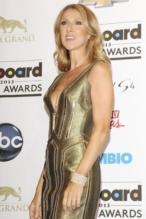 Celine Dion wears a gold dress at the 2013 Billboard Music Awards