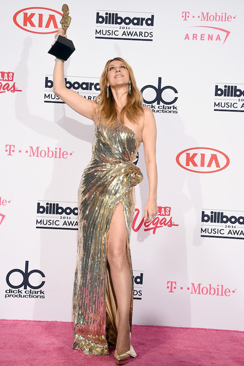 Celine Dion wears a gold gown with a high slit on the red carpet at the 2016 Billboard Music Awards