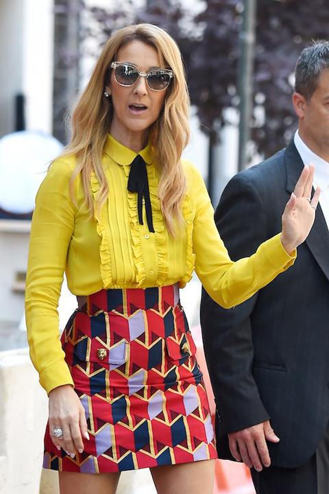 Celine Dion wears a yellow blouse and print skirt in New York in 2016