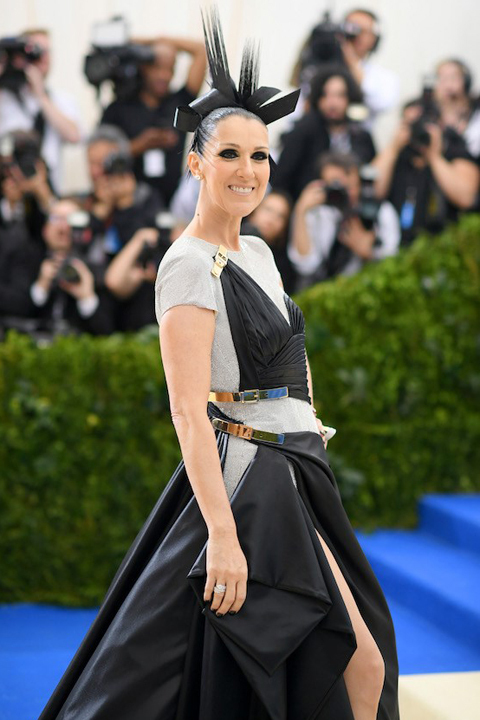 Celine Dion wears a black and white outfit and headpiece to the 2017 Costume Institute Gala