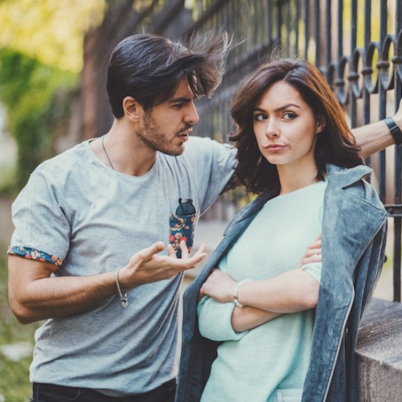 Woman looks away from partner skeptically
