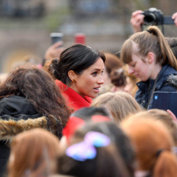 Meghan, Duchess of Sussex among a sea of royal watchers.