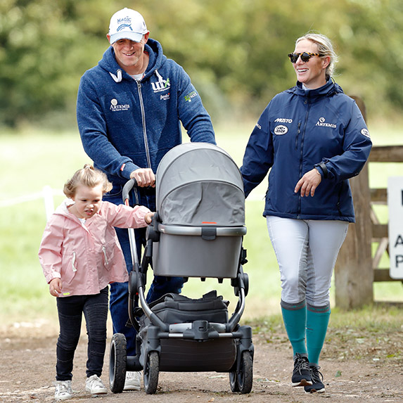 Lena Tindall in a stroller with her sister Mia and royal family