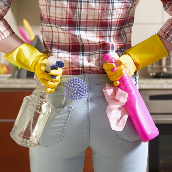 A woman prepared to clean