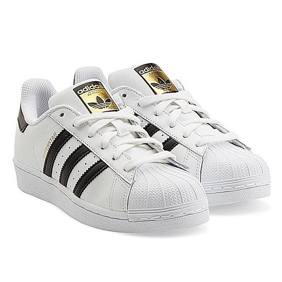 White shoe with three black stripes