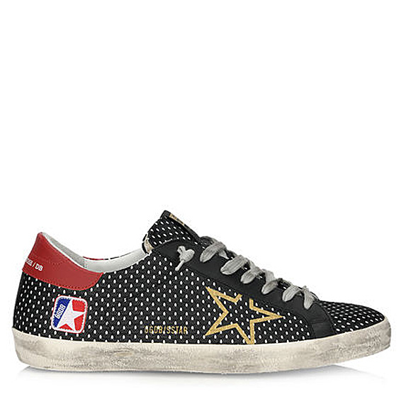 Worn-looking black sneakers with gold star