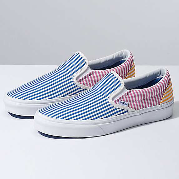 Blue, red and yellow striped canvas slip-on sneakers