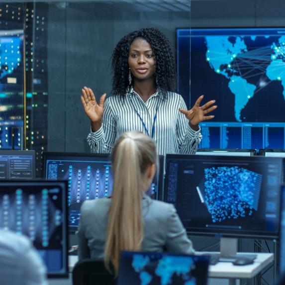 Senior data scientist speaking to staff