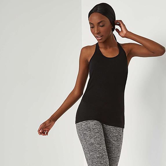 Woman in blank tank and grey leggings