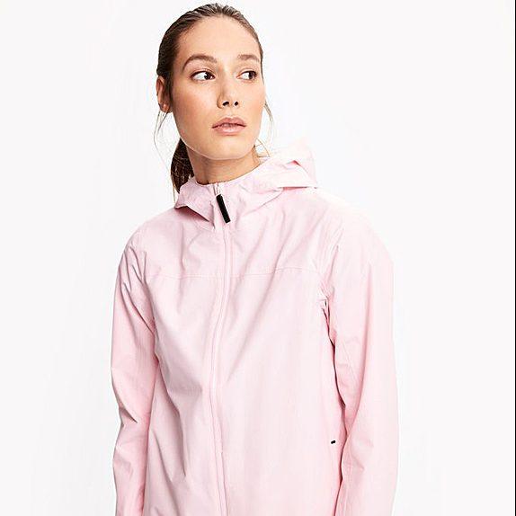 Woman in pink windbreaker and leggings