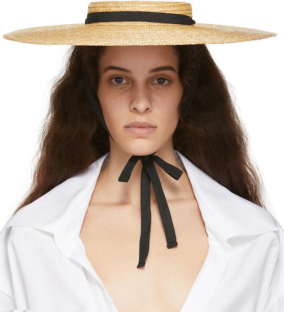 Model wears sun hat with ribbon tie